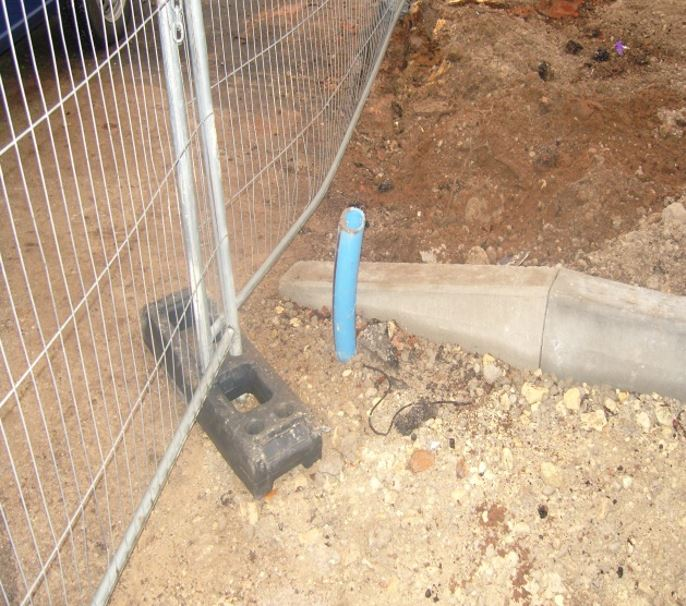 This picture shows what we are faced with some times when we attend site - a piece of MDPE pipe sticking out of the ground.